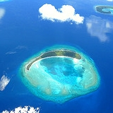 Atoll.  Photograph of a partially submerged atoll in the Maldives.  This icon denotes the atoll portion of the name Dam-Atoll.  ©Ahmed Zahid; image used with his kind permission.  Flickr address:  http://www.flickr.com/photos/ahmedzahid/271481822/; Flickr location:  http://farm1.static.flickr.com/81/271481822_9a095826a6_m.jpg